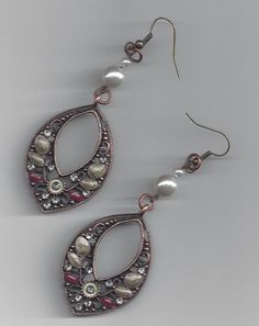 Oval shape earrings with faux pearls on by RoseFireDesigns on Etsy