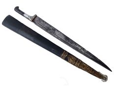 Solid and impressive afghan Khyber knife in its original brass mounted leather lined wooden scabbard.