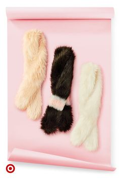 Gift your fashion fan classic and comfy faux fur stoles in blush, black and white.