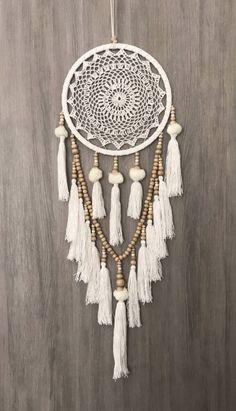 26.5cm Boho Crochet Web Dream Catcher White/Cream Pom Poms Tassels & Wood Beads https://www.etsy.com/listing/582731248/265cm-boho-crochet-web-dream-catcher
