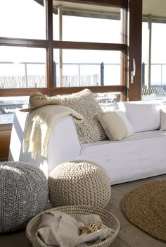 Textured poufs and rug and pillows - white & neutrals