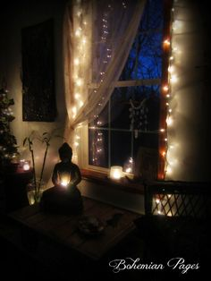 Faerie lights and wispy curtains adorn this charming window still life.
