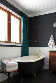 """Amanda's """"Dramatic Slate"""" Bathroom The dark wall color is Wrought Iron by Benjamin Moore in the flat finish. The base of the clawfoot tub is the same color as well."""