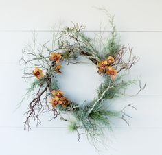 Bare branches, juniper branches, winter bud branches, cymbidium orchid blooms, air plants.