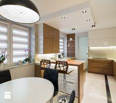 Elegancki dom w barwach ziemi - Średnia otwarta kuchnia w kształcie litery g z wyspą, styl nowoczesny - zdjęcie od studio wnętrz URBAN-DESIGN