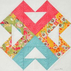 """Oooohhh! I really dig this """"Hearts Around"""" block by Marjorie Rhine of Quilt Design NW, particularly since the hearts are so subtle."""