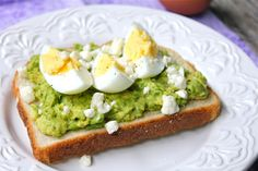 avocado and egg toasts with feta. something new to try for breakfast