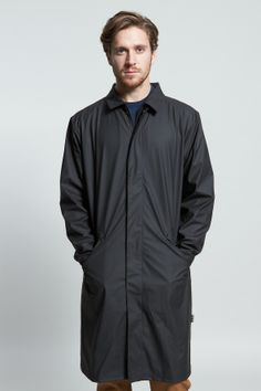The Mac Coat, Rains waterproof macintosh coat has a front zip and button fastening, long sleeves, diagonal side pockets with weather flaps, back weather flap in black. Click to buy.