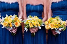Blue dresses, Yellow bouquets with smaller flowers and grey and green accents