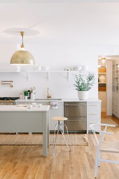 Make a statement in yo ur kitchen with show-stopping pendants. See 8 of our favorites here! http://www.stylemepretty.com/living/2016/06/09/8-statement-pendants-that-look-killer-over-a-kitchen-island/