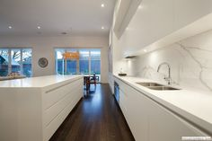 #Gloss tile #splashback has been used for this ultra modern kitchen design.