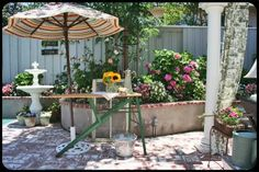 What a fun way to use a vintage ironing board outside ~ The Old Painted Cottage ~ November 2011 Cottage of the Month Wood Ironing Boards, Vintage Ironing Boards, Outdoor Retreat, Outdoor Rooms, Outdoor Decor, Backyard Cottage, Painted Cottage, Vintage Lighting, Outdoor Entertaining