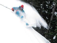 Big mountain pro skier Seth Morrison lays out a big turn in deep snow. I Photo Credit: Michael Brackenhofer I © Last Frontier Heliskiing