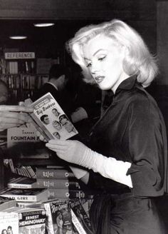 Marilyn Monroe reading The Big Brokers. Photographed by Andre De Dienes 1953. Some critics suggest that her love of books was not genuine. The numerous photographs showing her reading shows a desperate need to be taken seriously as a thinking and intellectually curious woman. Were that the case, there most likely would not be candid photographs of her reading books like Ulysses.