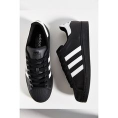 adidas Black Superstar Sneaker ($80) ❤ liked on Polyvore featuring shoes, sneakers, adidas, leather footwear, adidas trainers, black sneakers, adidas sneakers and rubber sole shoes