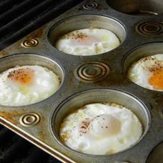 Eggs on the Grill | Did this for our camping trip and it turned out well. I used an aluminum muffin pan and greased it very well. I like mine crispy so I had placed half of the pan directly on the fire a little longer. -moaa