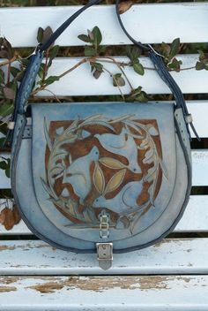 sky blue bag with hand carved triskele hares design -- -And also this one: http://www.skyravenwolf.com/images/uploaded/big_images/484--blue%20hare%20bag%201%20main.jpg