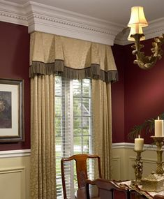Wow! Look at that crown molding! And how it was incorporated into the window treatment- so clever.