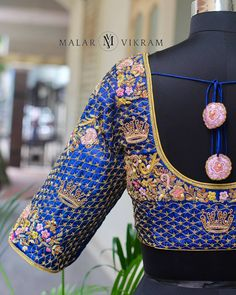 Stunning blue color designer bridal blouse with floral crown peacock design hand embroidery thread work. 11 July 2018