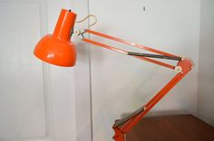 This mid century orange lamp puts off a bright light and has a highly adjustable body, making it the perfect work lamp. Mid Century Modern Lamps, I Love Lamp, Lamp, Work Lamp, Modern Furniture, Orange Lamps, Metal Desk Lamps, Mid Century, Modern Lamp