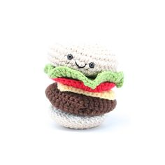 Knit Cheeseburger Baby Toy - crocheted by hand and includes multiple pieces. Adorable + perfect for kitchen play! #PNshop #babygift #giftidea