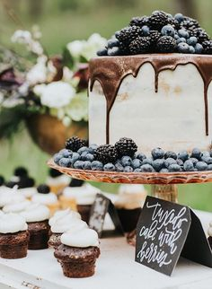 drip cake with blueberries and blackberries