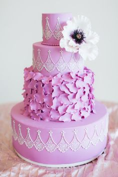 This opulent lilac-colored cake. | 25 Incredibly Beautiful Wedding Cakes That Won 2015