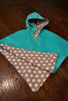 Free Sewing Tutorial – DIY Hooded Poncho Ok so here goes… my first sewing tutorial… be patient with me and please please please ask questions if anything is not clear. There are 3 pattern pieces.  Easy Easy Easy. A Front. A Back. A Hood. (make sure to cut a left and right side). Pattern Pieces:… Continue reading Reversible Poncho / Cape Tutorial