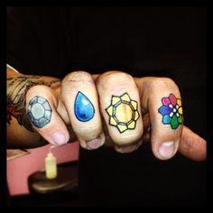 Pokemon gym badges finger tattoos.