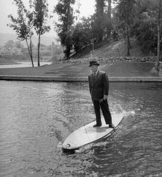 Just a man in a suit riding across a lake on a motorized surfboard while smoking a cigarette. 1948. pic.twitter.com/mKE3dY30ZU