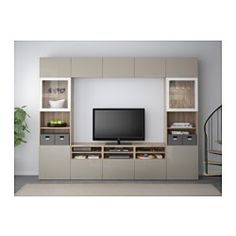 IKEA - BESTÅ, TV storage combination/glass doors, walnut effect light gray/Selsviken high gloss/beige clear glass, drawer runner, push-open, , The drawer and doors have integrated push-openers, so you don't need handles or knobs and can open them with just a light push.This TV storage combination has plenty of extra storage and makes it easy to keep your living room organized.The space-saving wall cabinets make the most of the wall area above your TV.It's easy to keep the cords from your TV…