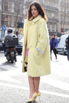Eleonora Carisi in a fuzzy pastel coat and matching pumps.