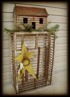 Rustic Log Cabin...sitting on an old chicken crate with pine & a star.