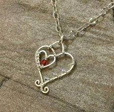 Handmade Sterling Silver and Swarovski Crystal Wire Wrapped Heart Pendant by Jersica