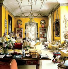 Yes, Yellow!  Nancy Lancaster's famous yellow drawing room in London, which was decorated by John Fowler using numerous layers of glaze over a butter yellow paint.