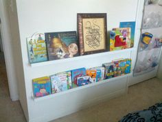 DIY kid's room. Great way to display children's books by using picture shelves from Ikea. I then hung them at my son's height level.