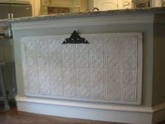 Pressed tin magnet board on a kitchen island.