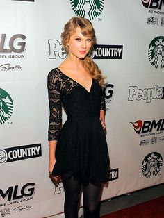 Love Taylor Swift and this black dress with lace sleeves!