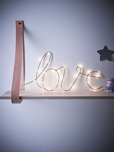 Bring a little love to any room with this delicate silver wire light. The elegant looped letters are strung with warm white LED bulbs, and can be…
