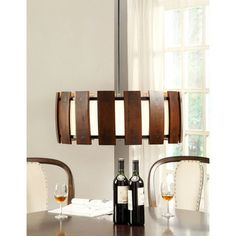 @Overstock.com - Schoolhouse Wood 3-light Medium Walnut Pendant - Add an inspired touch to any room in your home with the Schoolhouse Wood pendant, featuring a medium walnut stain finish. This effulgent fixture also highlights a three-light design and a wood slat shade.  http://www.overstock.com/Home-Garden/Schoolhouse-Wood-3-light-Medium-Walnut-Pendant/7732032/product.html?CID=214117 $78.99