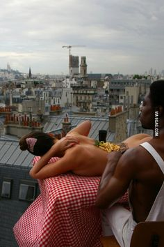 Eddie Murphy eating steak and fries off the back of a model in 1985, Paris.