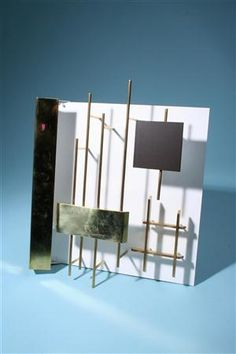 Beautiful sculptural wall sconce by Gio Ponti.