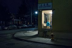 Looking through night windows... alone in the laundromat...