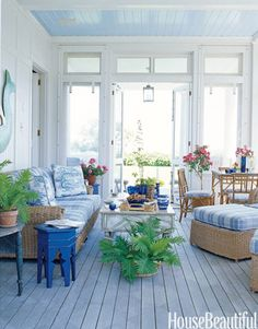 Architect Gil Schafer converted an open porch to a screened porch and, next to it, a dining room. Color expert Eve Ashcraft chose Narragansett Green for the porch floor and Stonington Gray for the ceiling, both from Benjamin Moore.