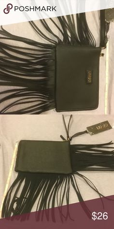 """Fringed Wristlet If you want a wristlet with a lot of pizzazz, this one will work with its long fringes on two sides.   The zipper goes across the top and down the side without fringes.  This is a fun Italian brand.   The bag itself measures about 8 x 5 1/2"""". The bottom fringes are another 6 1/2"""". Liu Jo Bags Clutches & Wristlets"""