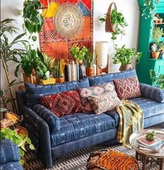 Who's ready to move to Justina's with us? Think she'll let us stay?  Jungalow products are in stock at #CityHome like this couch and this fabulous sun mirror! Photo: Dabito, The Jungalow by Justina Blakeney