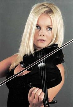 Mairead Nesbitt of Celtic Woman - Love them and Mairead is amazing! Running and dancing the whole time she's playing the violin with incredible speed and skill.