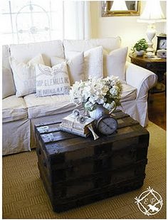 Gorgeous Room Love The White Slipcovers Against Dark Steamer Trunk Coffee Table By