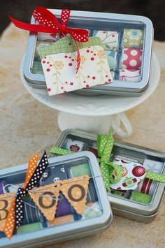 Gift idea:  sassy little tins with see-thru window are filled with Hershey's Nuggets wrapped in coordinating paper patterns. Add a tag and some ribbon and you've got the perfect little gift for someone special.