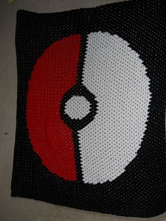 This Pokeball afghan is constructed in one piece using intarsia. The pattern is written in standard US abbreviations.